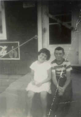 This photo was taken when the store was located in our house prior to the 1958 storefront addition.  Shown in the photo are my sister Peggy and our cousin Tommy Lavin, who lived a few houses away.