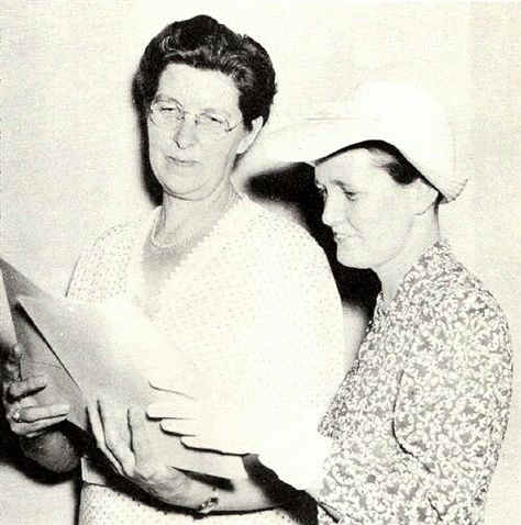 Miss Jean Peoples, left, looks over the history of the Society's 35 years, prepared by Mrs. John Wills, right; Photo from The Delaware County Advocate, July 1942